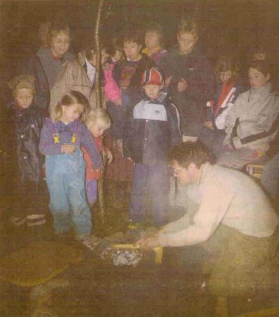 cooking-leg-of-lamb-in-viking-cooking-pit