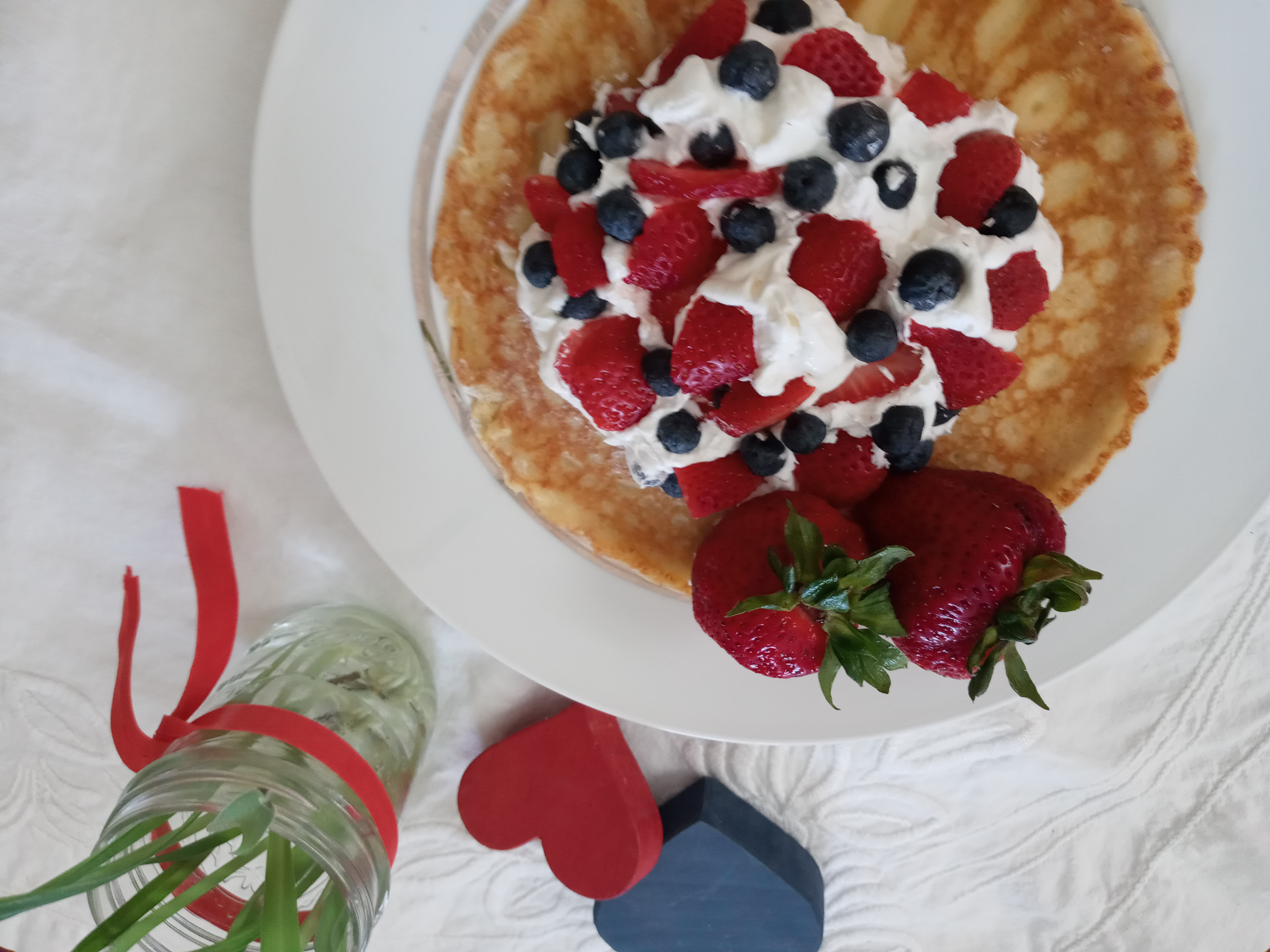 pancake strawberries blueberries whipped cream